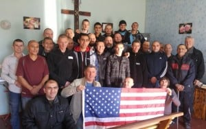 Ukrainian prisoners pose with us and the American flag