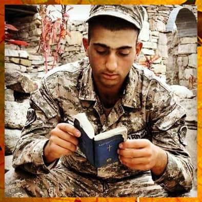 Young Armenian soldier reads his bible.